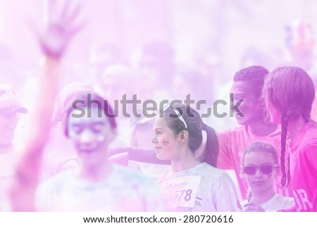 STOCKHOLM, SWEDEN - MAY 23: Girl in purple looking at something at Stockholm Color Run in Tantolunden or Tanto on May 23, 2015. People from all walks of life participated in the run. - stock photo