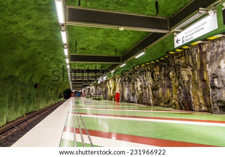 "STOCKHOLM, SWEDEN - MAY 30: Interior of Kungstradgarden metro station on May 30, 2014 in Stockholm. The metro system is called ""the world's longest art gallery"" with generously decorated stations. - stock photo"