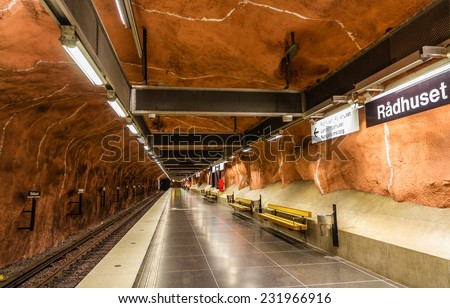"STOCKHOLM, SWEDEN - MAY 30: Interior of Radhuset metro station on May 30, 2014 in Stockholm. The metro system is called ""the world's longest art gallery"" with generously decorated stations. - stock photo"