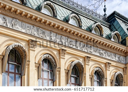 STOCKHOLM, SWEDEN - May 07, 2017: Jernkontorets gamla building decorated with 57-meter-long reliefs from gray cement by sculptor Johan F. Kjellberg describing the history of Swedish iron management.