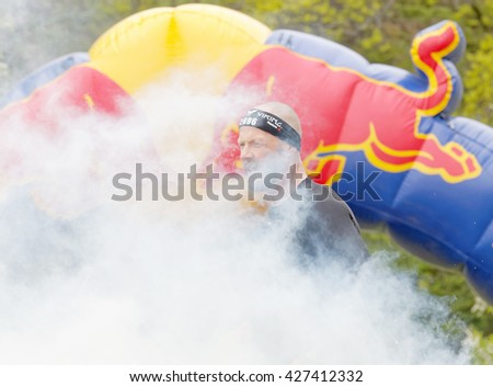 STOCKHOLM, SWEDEN - MAY 14, 2016: Men partly covered in smoke in the obstacle race Tough Viking Event in Sweden, April 14, 2016