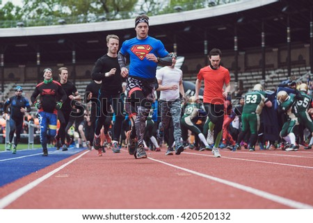 STOCKHOLM, SWEDEN - MAY 14, 2016 Start of the Tough Viking obstacle course in Stockholm Stadion with the first obstacle the American football players.