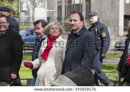 STOCKHOLM, SWEDEN - MAY 1: Stefan Lofven, Social Democratic Party leader Sweden, and his wife Ulla Lofven in May 1 parade through Stockholm on International Worker´s Day May 1, 2014.  - stock photo