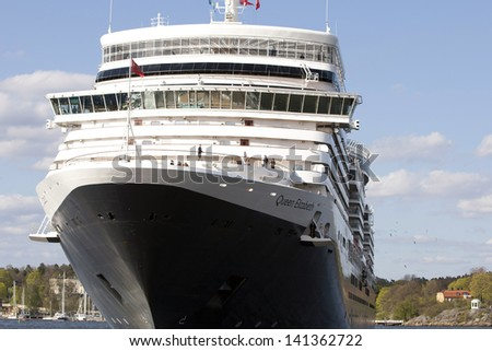 STOCKHOLM, SWEDEN - MAY 11: The big Cruise Ship Queen Elisabeth leaves Stockholm Harbor on the Toure Scandinavia and Russia, Stockholm, Sweden, 11th May 2013.