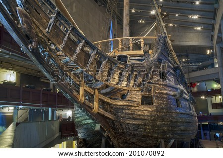 STOCKHOLM, SWEDEN  MAY 17, 2014: The Vasa Museum displays the only almost fully intact 17th century ship that has ever been salvaged, the 64-gun warship Vasa that sank on her maiden voyage in 1628. - stock photo