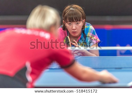 STOCKHOLM, SWEDEN - NOV 18, 2016: Barbora Balazova (SVK) vs Hyowon Suh (KOR) at the table tennis tournament SOC at the arena Eriksdalshallen in Stockholm.