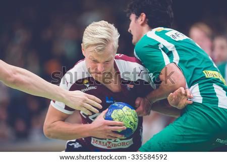 STOCKHOLM, SWEDEN - NOV 4, 2015: Hampus Jildenback pushing throug the defence at the Handball game between Hammarby vs Lugi at Eriksdalshallen. Allsvenskan Swedish leugue - stock photo