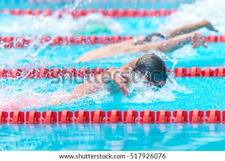 STOCKHOLM, SWEDEN - NOV 5, 2016: Sideview of butterfly swim at the National Swedish swim championships at Eriksdalsbadet.