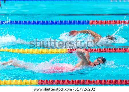 STOCKHOLM, SWEDEN - NOV 5, 2016: Swimmers crawling at the National Swedish swim competition at Eriksdalsbadet.