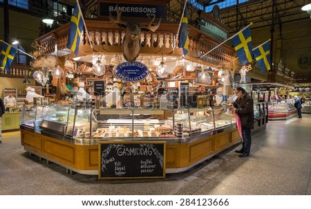 STOCKHOLM, SWEDEN â?? NOVEMBER 10: Ostermalm market hall on November 10, 2014 in Stockholm. The famous Ostermalm market hall was opened in 1888. - stock photo
