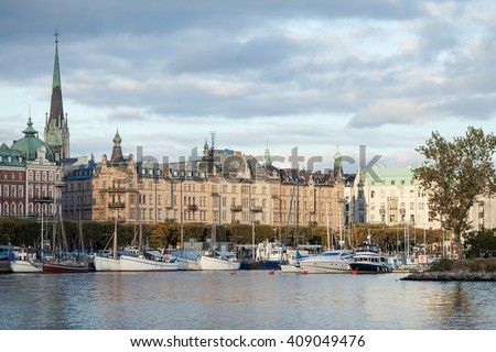 STOCKHOLM, SWEDEN - OCTOBER 11, 2015: Nybroviken port in Stockholm. Elegant homes, shops, and private boats line the waterfront of Stockholm's Ostermalm neighborhood.