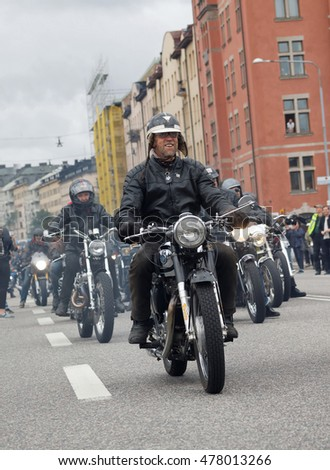 STOCKHOLM, SWEDEN - SEPT 03, 2016: Group of senior bikers on old fashioned motorcycles at the Mods vs Rockers event at the St:Eriks bridge, Stockholm, Sweden, September 03, 2016