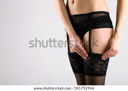 Stockings on perfect woman legs, close up - stock photo
