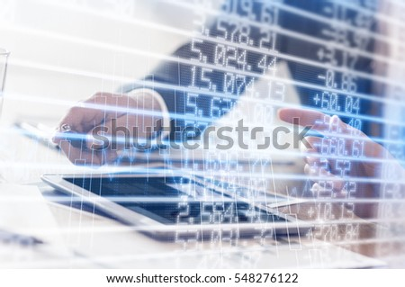 Stocks and shares against business people using tablet
