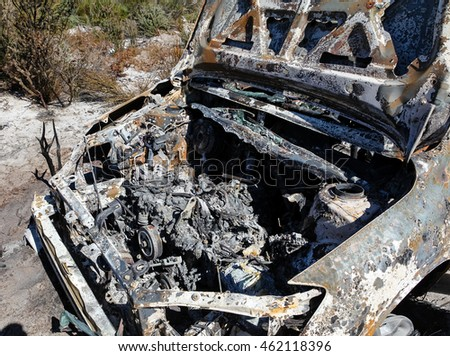 Stolen vehicle has been abandoned in bushland and then set on fire to hide any evidence of the person or people who took it. Outback Australia.