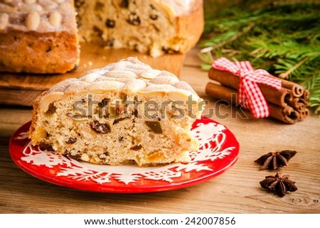 Stollen cake on an old rustic wooden table