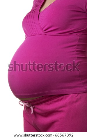 Stomach of pregnant woman over white background - stock photo