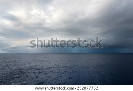 Stomy clouds over the ocean - stock photo
