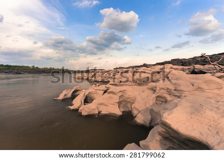 stone and blue sky at Mekong River in Ubonratchathani ,Thailand. - stock photo