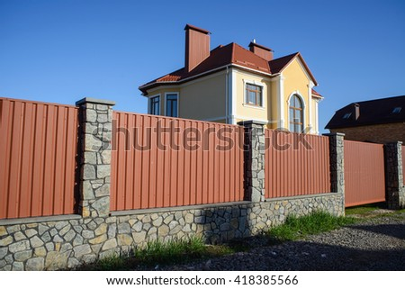 Stone and Metal Fence with Door of Modern Style Design - stock photo