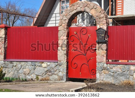 Stone and Metal Red Fence with Door of Modern Style Design Decorative Cracked Real Stone Wall Surface With Cement.
