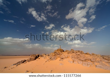 Stone and sand in the Sahara Desert - stock photo