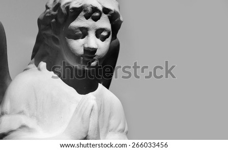 Stone angel in black and white (details) - stock photo
