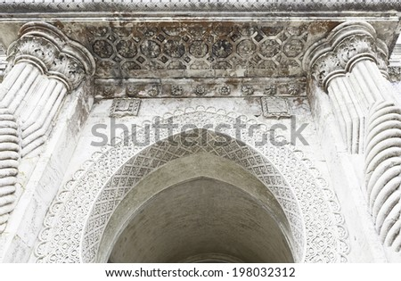 Stone arch decorated, detail of a wall decorated in stone, ancient art