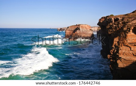 Stone arches at Playa de las Catedrales during high tide. The Bay of Biscay. Atlantic. Ocean. Spain - stock photo