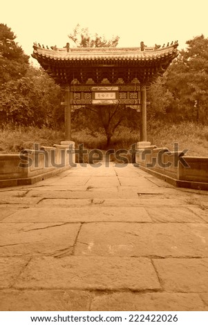 stone archway and stone bridge at a Chinese ancient garden - stock photo