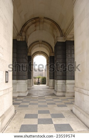 Stone archway in the Merchant Navy war memorial gardens at Tower Hill, London, England - stock photo