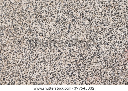 Stone background made of a closeup of a pile of pebbles - stock photo