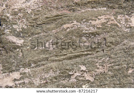 Stone background. Surface of a rock showing lines and sand. - stock photo