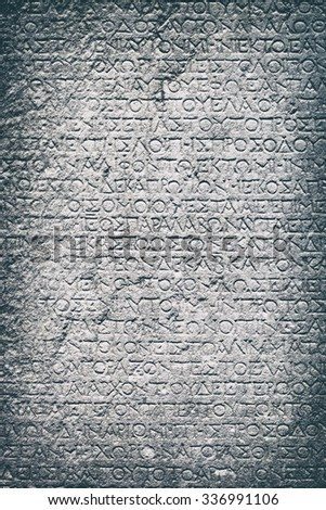 Stone background with antique Greek inscriptions - stock photo