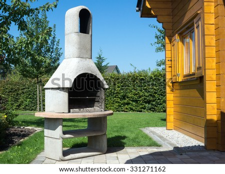 Stone barbecue in a garden / Stone Barbecue - stock photo