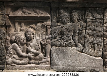 Stone bas relief from the Prambanan Temple near Yogyakarta, Central Java, Indonesia. - stock photo