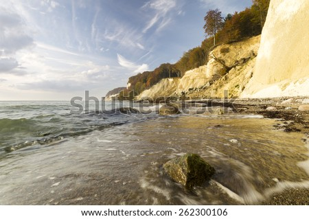 Stone beach under the cliff on the island of Rügen - stock photo