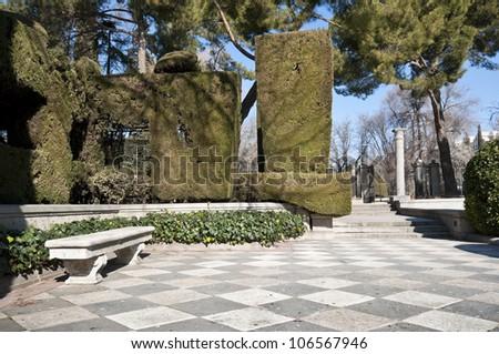 Stone bench in Cecilio Rodriguez Gardens, Retiro Park, Madrid, Spain - stock photo