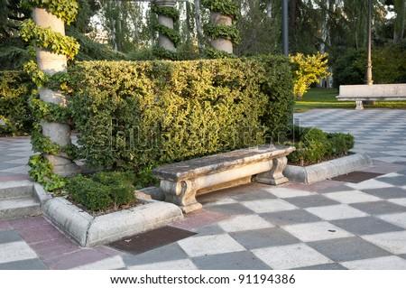 Stone bench. Stone bench in Cecilio Rodriguez gardens, Retiro Park, Madrid, Spain - stock photo