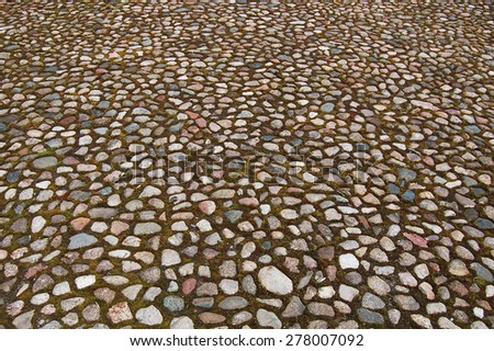 Stone blocks in the walkway - stock photo