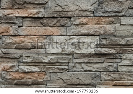 stone brick decorative wall as background - stock photo