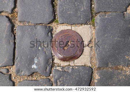 Stone brick with old metal sewer.