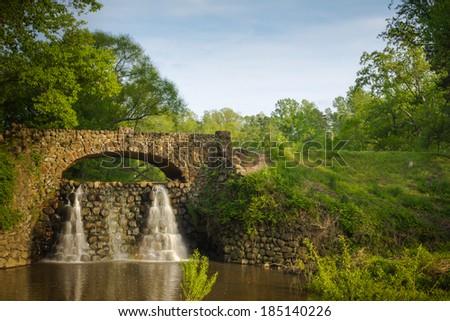 Stone Bridge and Waterfall in Reynolda Gardens - stock photo