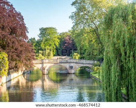 Stone bridge cross Cam river with colorful tree in Cambridge, England