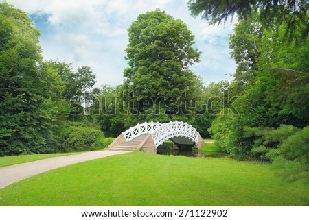 Stone bridge over the stream - stock photo