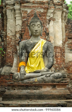 Stone Buddha with brick background in Ayutthaya of Thailand