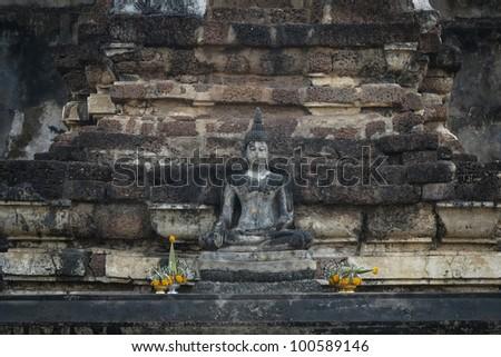 Stone Buddha with brick background, Thailand - stock photo