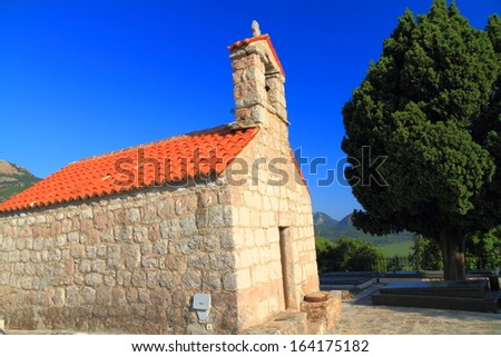 Stone building of orthodox monastery near the Adriatic sea - stock photo