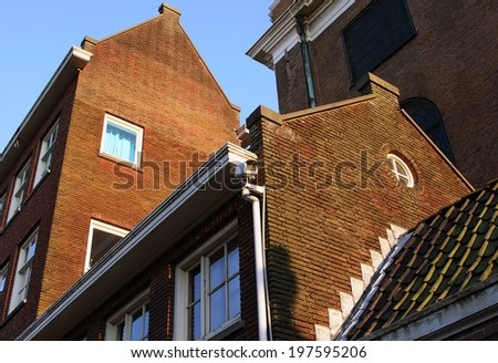 Stone buildings of Amsterdam - stock photo
