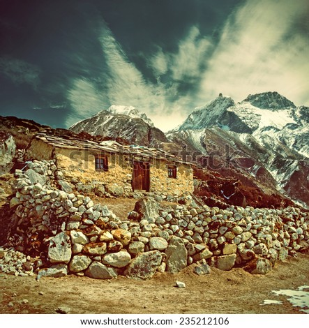 Stone cabin in the mountain, along the trail to Mount Everest Base Camp, Nepal Himalaya . Instagram toning effect. - stock photo